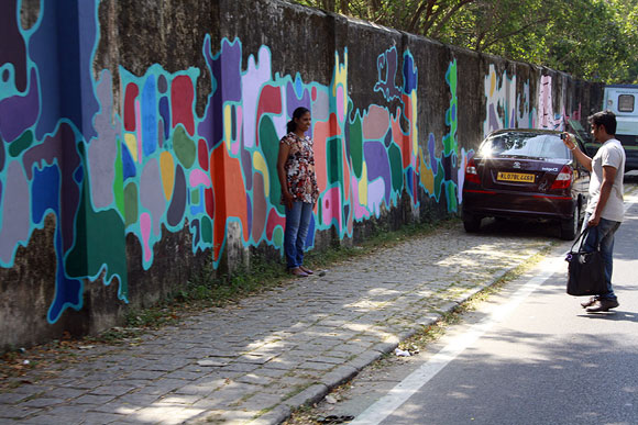 This couple can't resist capturing the street art on their camera
