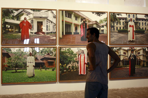 A visitor admires visual artist Anup Mathew Thomas's exhibit.