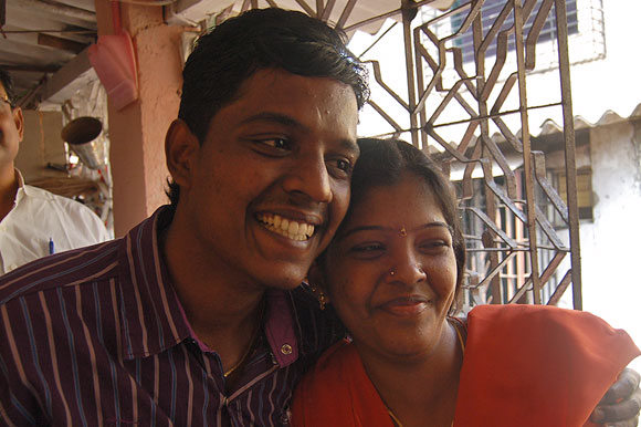 Happy siblings Dhanraj and Prema pose outside their one-room tenement in Malad, northwest Mumbai.