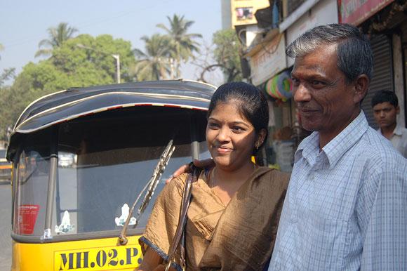 Jayakumar and Prema in front of the autorickshaw that Jayakumar drives.
