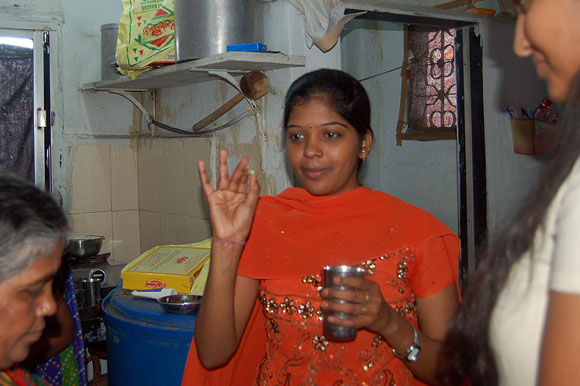Prema inside the family kitchen taking medicines; she was running a slight fever because of exhaustion.