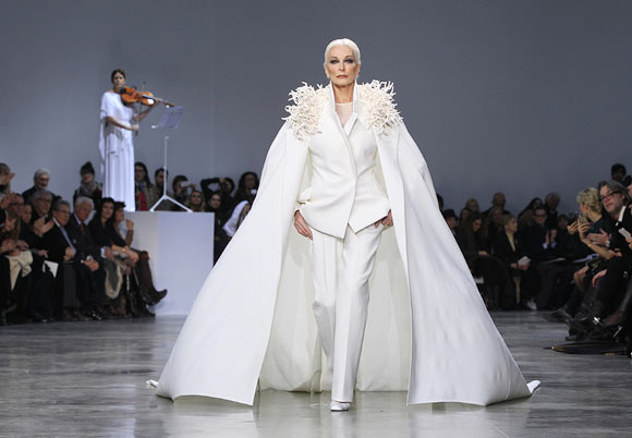 Carmen Dell'Orefice, 81, presents a creation by French designer Stephane Rolland as part of his Haute Coutu