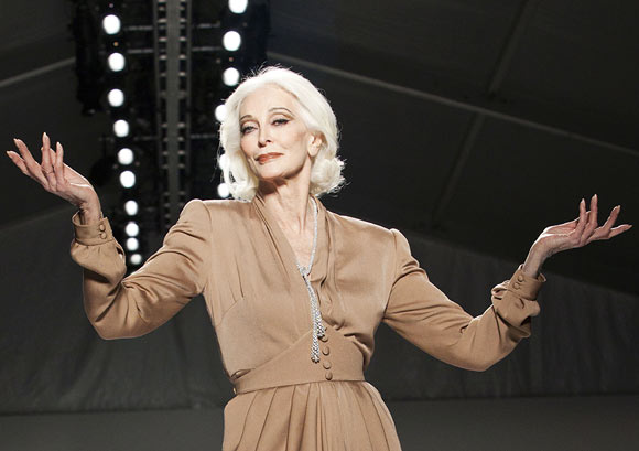 Model Carmen Dell'Orefice, 81, presents a creation from the Norisol Ferrari Spring/Summer 2013 collection during New York Fashion Week, September 10, 2012.