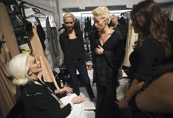 Fashion designer Norisol Ferrari (C) talks with model Carmen Dell'Orefice (L) prior to the presentation of her Spring/Summer 2013 collection during New York Fashion Week September 10, 2012. The collection is Ferrari's first runway show.