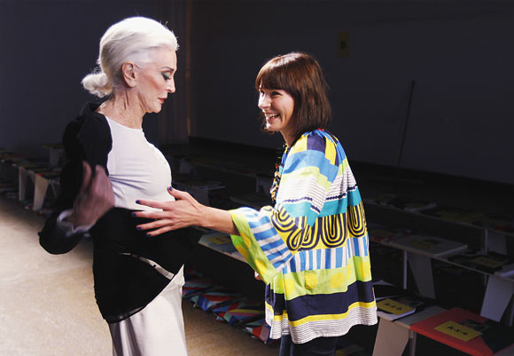 Designer Noora Niinikoski (R) laughs with model Carmen Dell'Orefice who presents a creation from the Marimekko Spring/Summer 2013 collection during New York Fashion Week September 10, 2012.