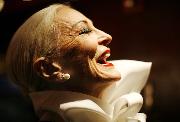 Carmen Dell'Orefice, who was born in 1931 and claims to be the world's oldest supermodel, laughs backstage before the 2007 Jackie Rogers fall collection during New York Fashion Week February 3, 2007.
