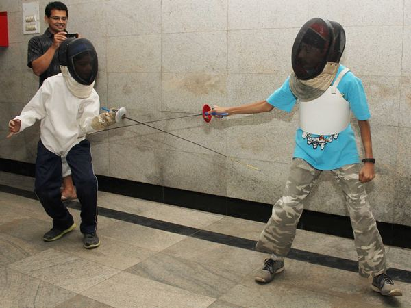 Like all sports that aren't cricket, fencing in India suffers from lack of infrastructure. Seen here are young boys practicing in a school foyer that is far from being conducive to the sport.