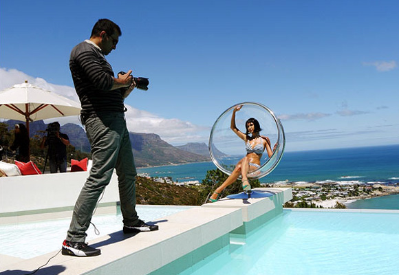 Photographers are employed at weddings, newspapers and magazines; seen in the picture above is ace lensman Atul Kasbekar during a Kingfisher calender shoot