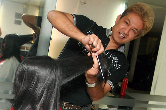 Jawed Habib working at his salon