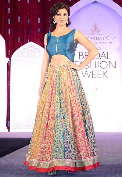 Jacqueline Fernandez walks the ramp for Jyotsna Tiwari at the Aamby Valley India Bridal Fashion Week Preview in Delhi on July 10, 2013