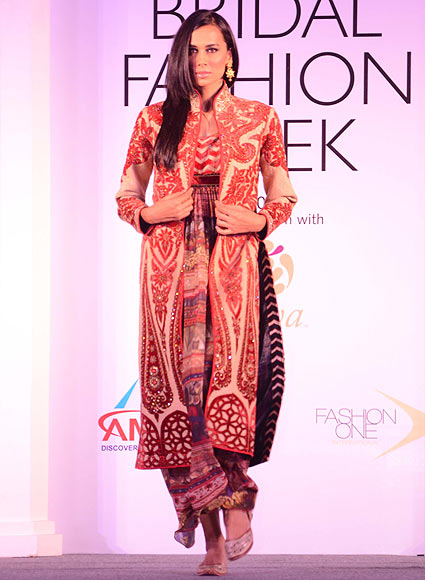 A model walks the ramp for JJ Valaya at the Aamby Valley India Bridal Fashion Week Preview in Delhi on July 10, 2013