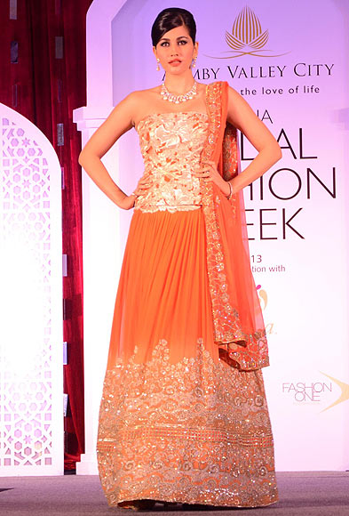 Anjali Lavania walks the ramp for Adarsh Gill at the Aamby Valley India Bridal Fashion Week Preview in Delhi on July 10, 2013