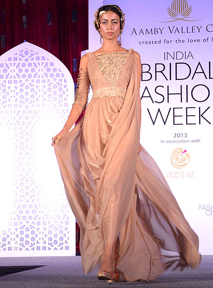 A model walks the ramp for Suneet Varma at the Aamby Valley India Bridal Fashion Week Preview in Delhi on July 10, 2013