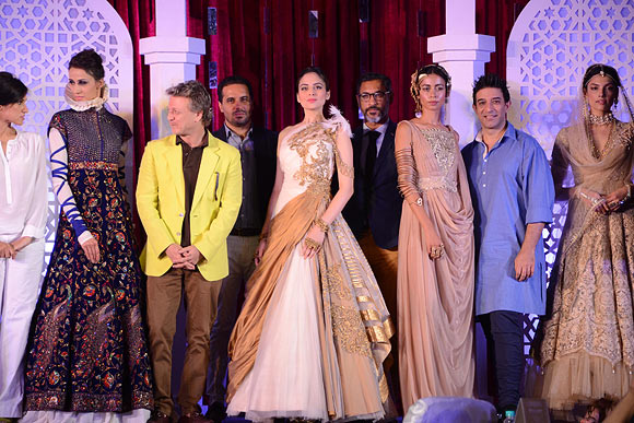 (L-R) Designers Rina Dhaka, Rohit Bal, Shantanu & Nikhil and Suneet Varma with their creations at the Aamby Valley India Bridal Fashion Week Preview in Delhi on July 10, 2013