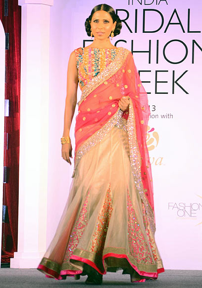 Candice Pinto walks the ramp for Jyotsna Tiwari at the Aamby Valley India Bridal Fashion Week Preview in Delhi on July 10, 2013