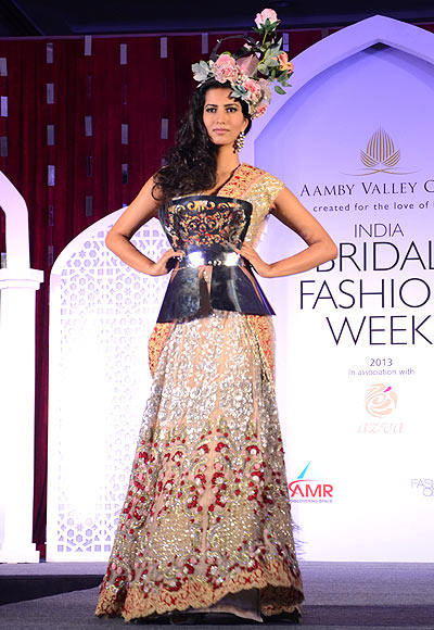 Manasvi Mamgai walks the ramp for Falguni & Shane Peacock at the Aamby Valley India Bridal Fashion Week Preview in Delhi on July 10, 2013