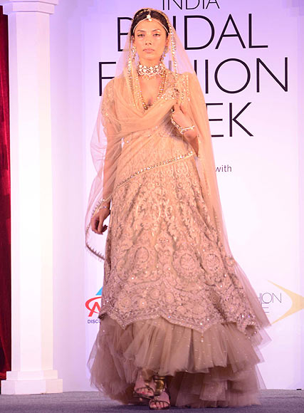 Indrani Dasgupta walks the ramp for Tarun Tahiliani at the Aamby Valley India Bridal Fashion Week Preview in Delhi on July 10, 2013