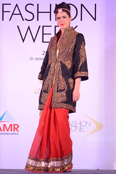 Sucheta Sharma walks the ramp for Raghavendra Rathore at the Aamby Valley India Bridal Fashion Week Preview in Delhi on July 10, 2013