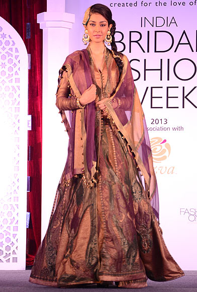 A model walks the ramp for Ashima Leena at the Aamby Valley India Bridal Fashion Week Preview in Delhi on July 10, 2013