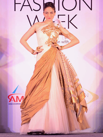 A model walks the ramp for Shantanu & Nikhil at the Aamby Valley India Bridal Fashion Week Preview in Delhi on July 10, 2013