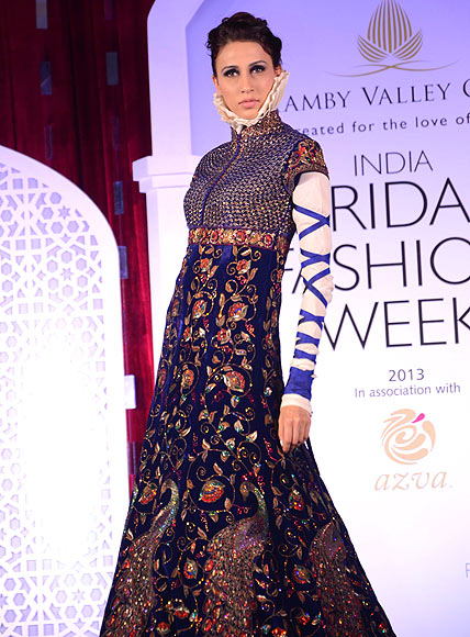 Alesia Raut walks the ramp for Rohit Bal at the Aamby Valley India Bridal Fashion Week Preview in Delhi on July 10, 2013