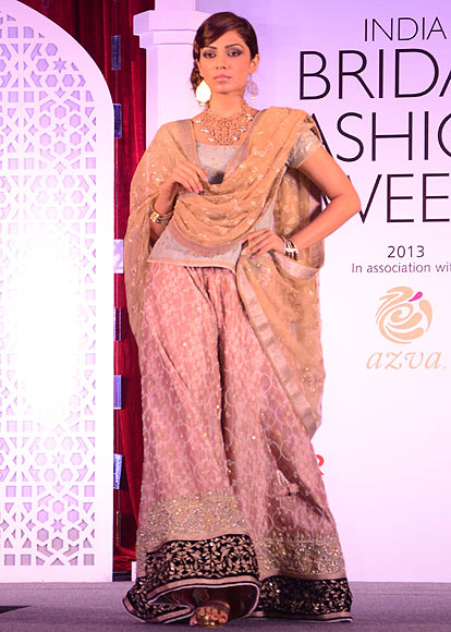 A model walks the ramp for Meera Muzaffar Ali at the Aamby Valley India Bridal Fashion Week Preview in Delhi on July 10, 2013