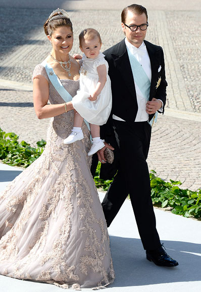Crown Princess Victoria of Sweden, Princess Estelle of Sweden and Prince Daniel of Sweden attend the wedding of Princess Madeleine of Sweden and Christopher O'Neill hosted by King Carl Gustaf XIV and Queen Silvia at The Royal Palace on June 8, 2013 in Stockholm, Sweden