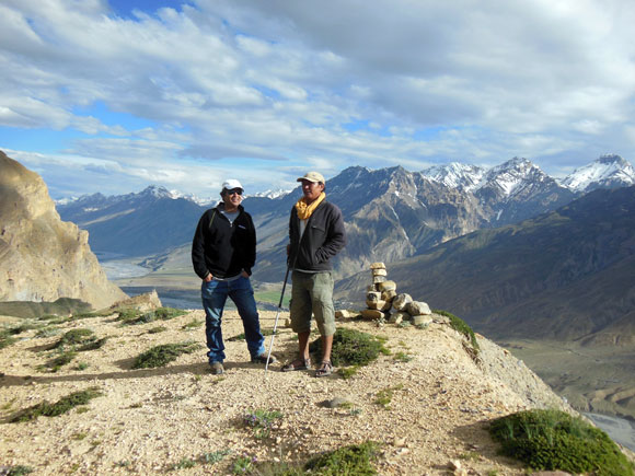 Sushil Dorje, right, has been involved in snow leopard research since 1996. Behind him is a camera-trap spot