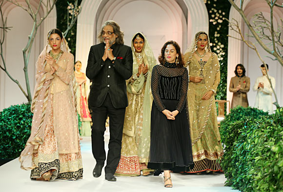 Muzaffar and Meera Ali flanked by their models
