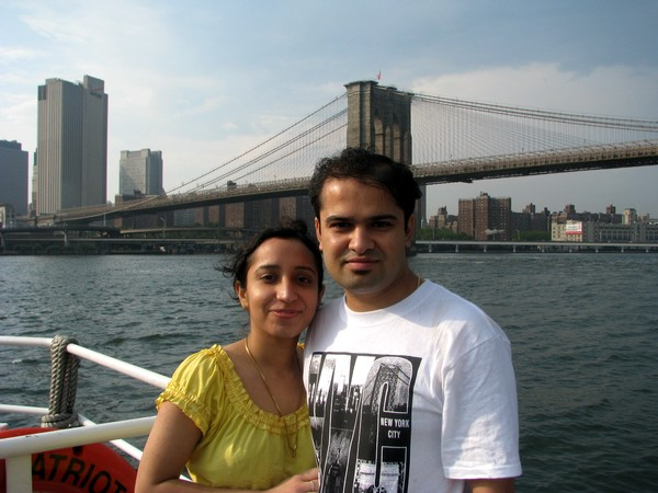 The author with his wife Kiran Chhabra and the iconic Brooklyn Bridge in the backdrop.