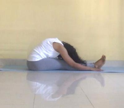 Paschimottanasana (seated forward/westward facing pose)