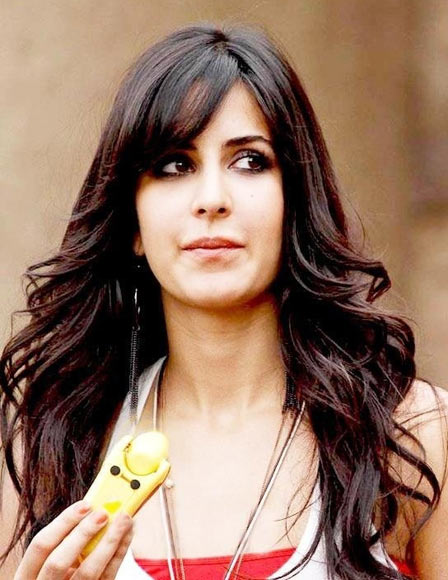 A face that is oblong like Katrina Kaif's will require bangs too