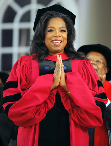 Media mogul Oprah Winfrey acknowledges the cheers from students and audience as she receives an honorary Doctor of Laws degree during Harvard University's 362nd Commencement Exercises in Cambridge, Massachusetts May 30, 2013