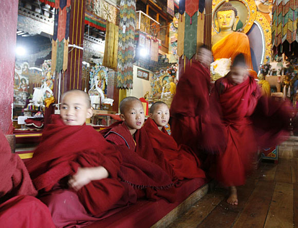 Child monks attend morning prayers inside the 17th century Tawang Tibetan Buddhist monastery in Arunachal Pradesh.