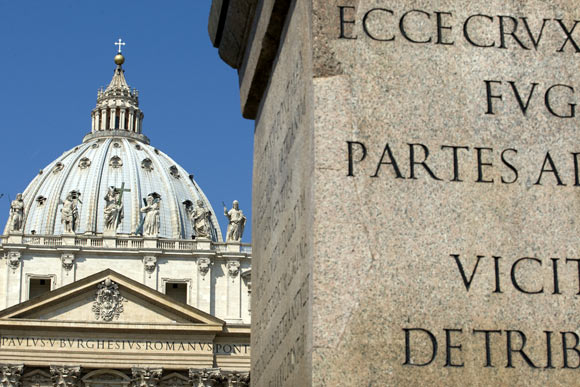 The obelisk (R) is seen near Saint Peter's Basilica, both of which play a part in novelist Dan Brown's book Angels & Demons, at the Vatican May 1, 2009.