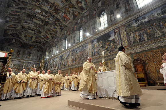 Newly elected Pope Francis I, Cardinal Jorge Mario Bergoglio of Argentina, leads a a mass with cardinals at the Sistine Chapel, in a picture released by Osservatore Romano at the Vatican March 14, 2013.