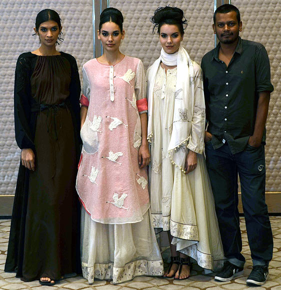 Vogue Fashion Fund 2013 semi-finalist Ajit Kumar with creations from his latest collection