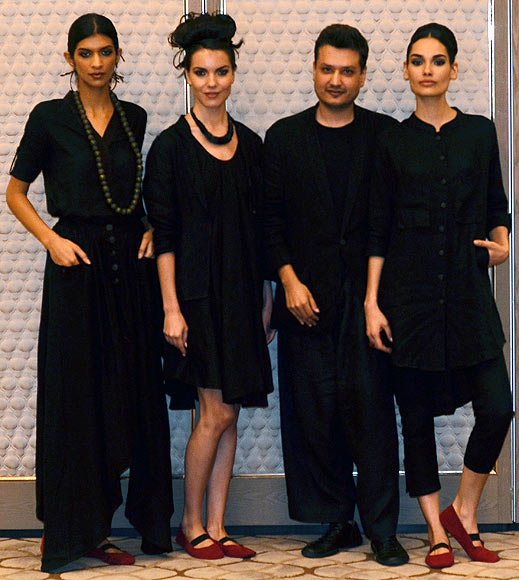 Vogue Fashion Fund 2013 semi-finalist Divyam Mehta with creations from his latest collection