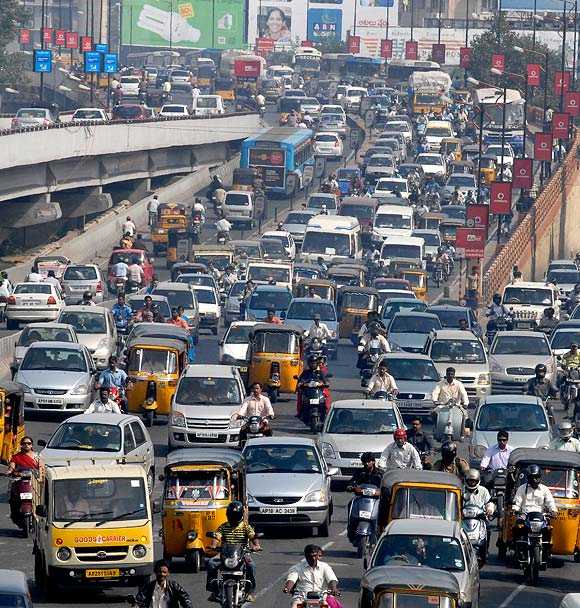 Vehicles move slowly during morning rush hour in the southern Indian city of Hyderabad