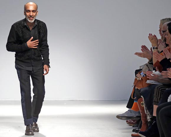 Manish Arora acknowledges applauses after the presentation of his Ready-to-wear collection at the Paris Fashion Week, February 28, 2013.