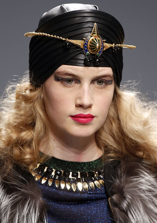 Manish Arora's models wore black leather turbans as they walked the ramp to music played on Indian instruments.
