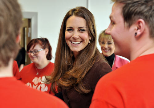 Britain's Catherine, Duchess of Cambridge speaks with unemployed young people who are taking part in The Prince's Trust Scheme, during her visit to Peaks Lane fire station in Grimsby, northern England March 5, 2013.