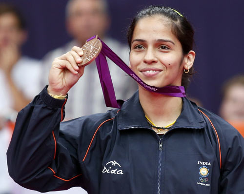 India's Saina Nehwal holds up her bronze medal at the women's singles badminton victory ceremony at the London 2012 Olympic Games at the Wembley Arena August 4, 2012.