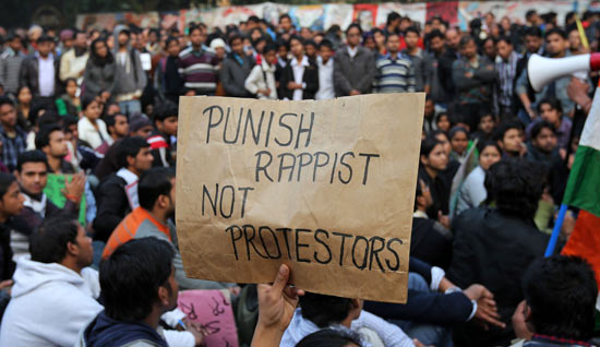 A demonstrator holds a placard during a protest in New Delhi December 24, 2012. Indian authorities throttled movement in the heart of the capital on Monday, shutting roads and railway stations in a bid to restore law and order after police fought pitched battles with protesters enraged by the gang rape of a young woman.