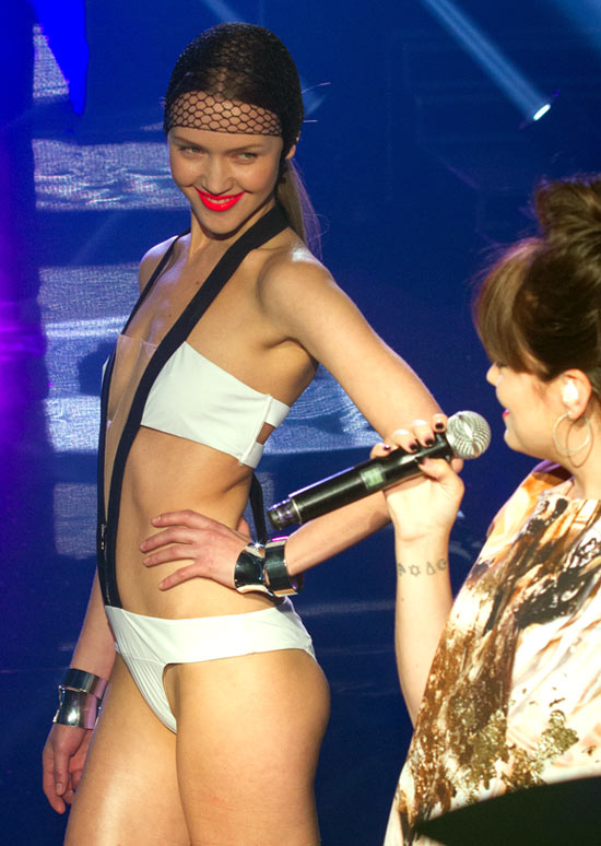 Singer Lily Allen (R) performs during the 'Etam Live Lingerie show' 2013 at Bourse du Commerce in Paris, France.