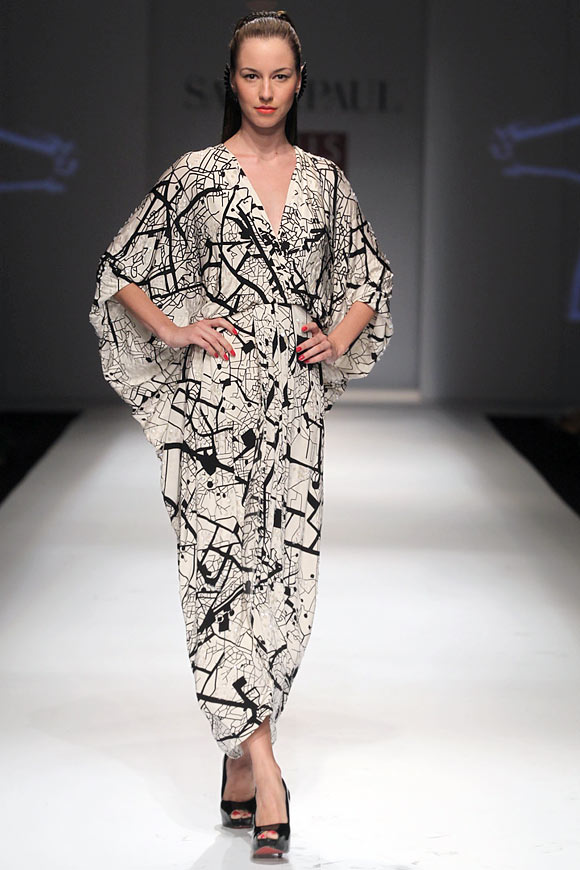 A model walks the ramp for Masaba in a black and white abstract print maxi dress.