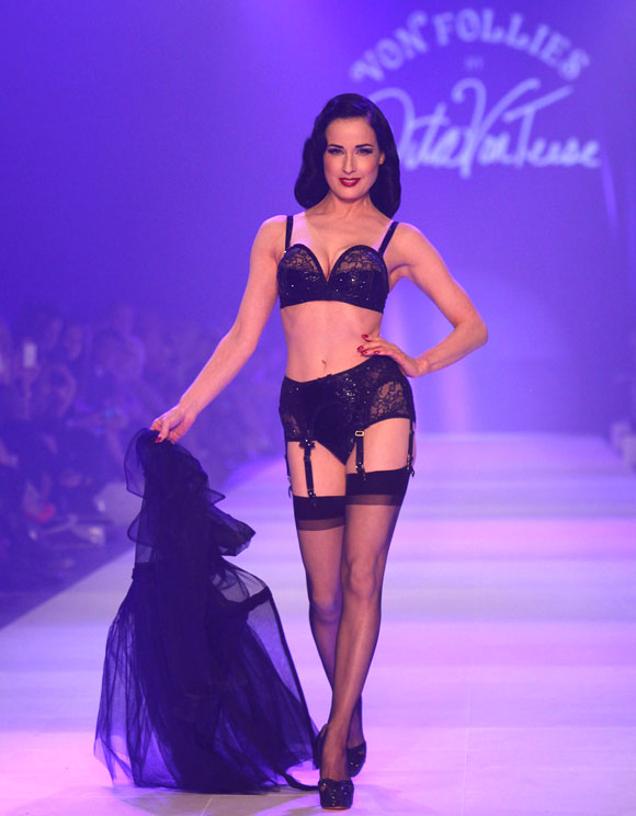 Dita Van Teese showcases designs by Von Folies by Dita Von Teese on the runway during L'Oreal Melbourne Fashion Festival on March 10, 2012 in Melbourne, Australia.