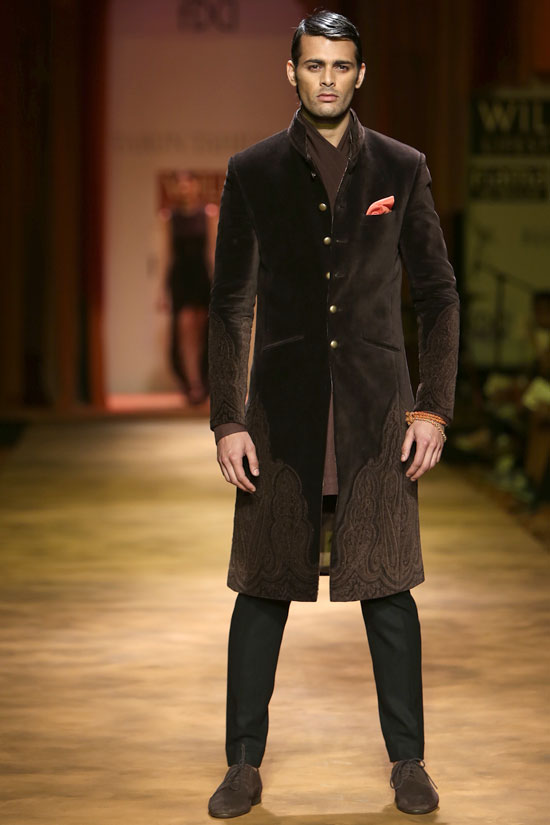 A model walks the ramp in a charcoal brown bandhgala.