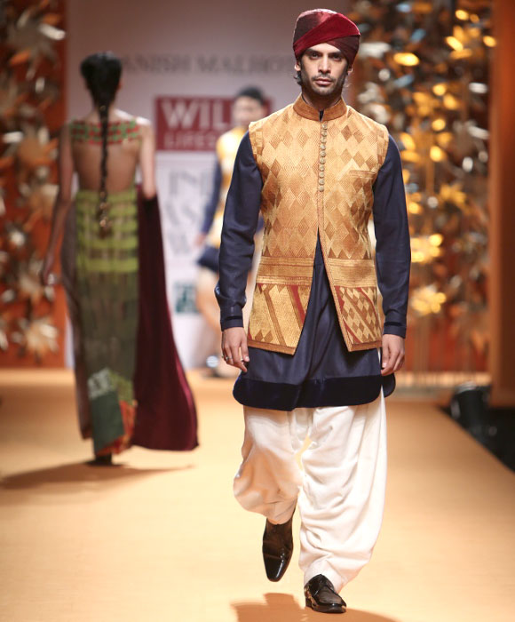 A model shows a creation by Manish Malhotra.