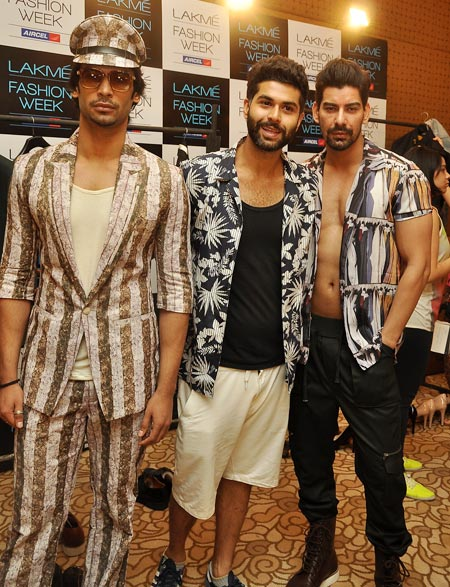 Models showcase Kunal Rawal's (centre) creations at the Lakme fittings